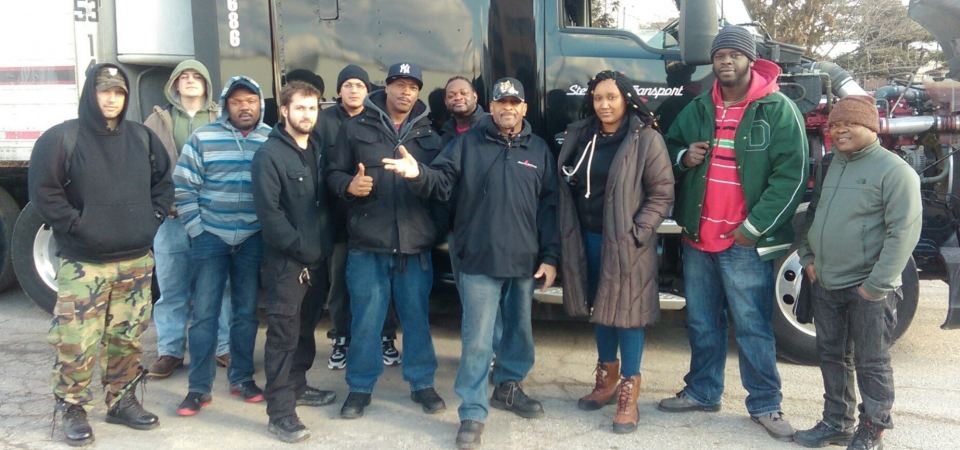 Pictured is KJ with a group of NETTS students and his Stevens Truck.